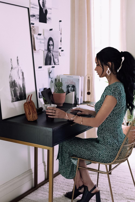 woman sitting beside table inside room