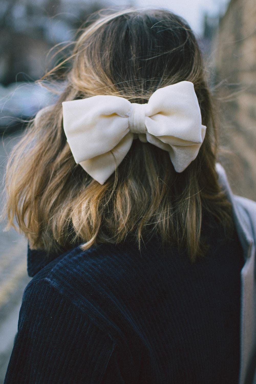woman wearing white ribbon tie