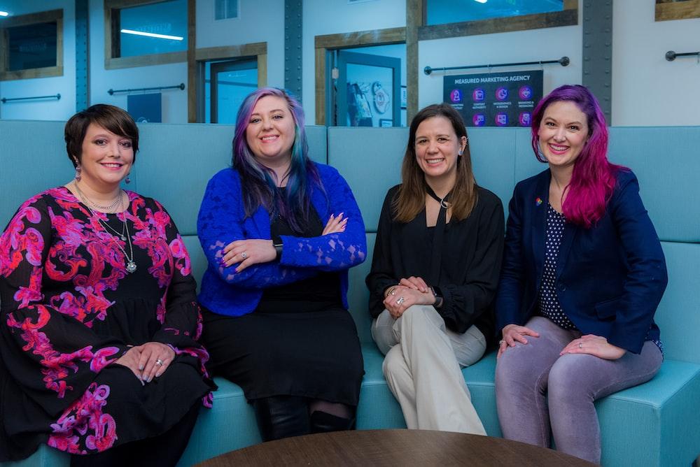 four women sitting on sofa