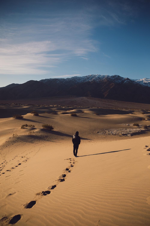 man walking on sand