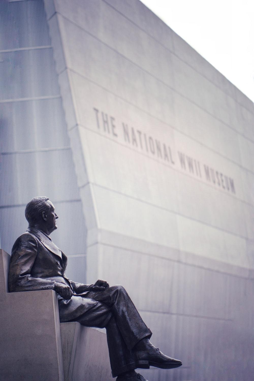 man sitting down statue