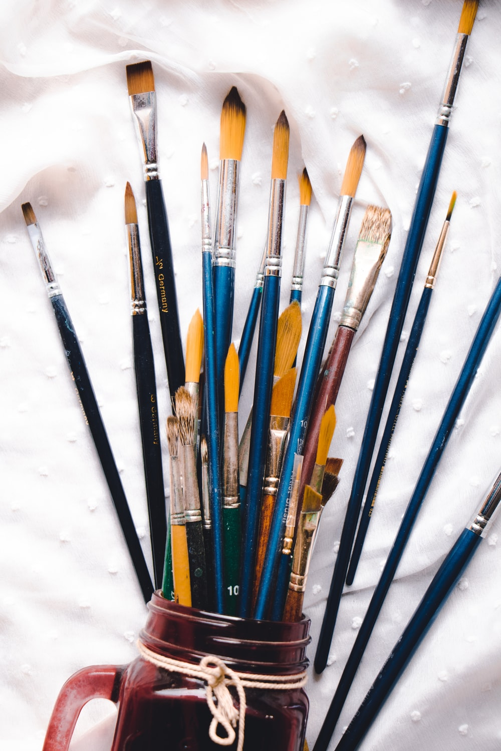 assorted-colored brushes