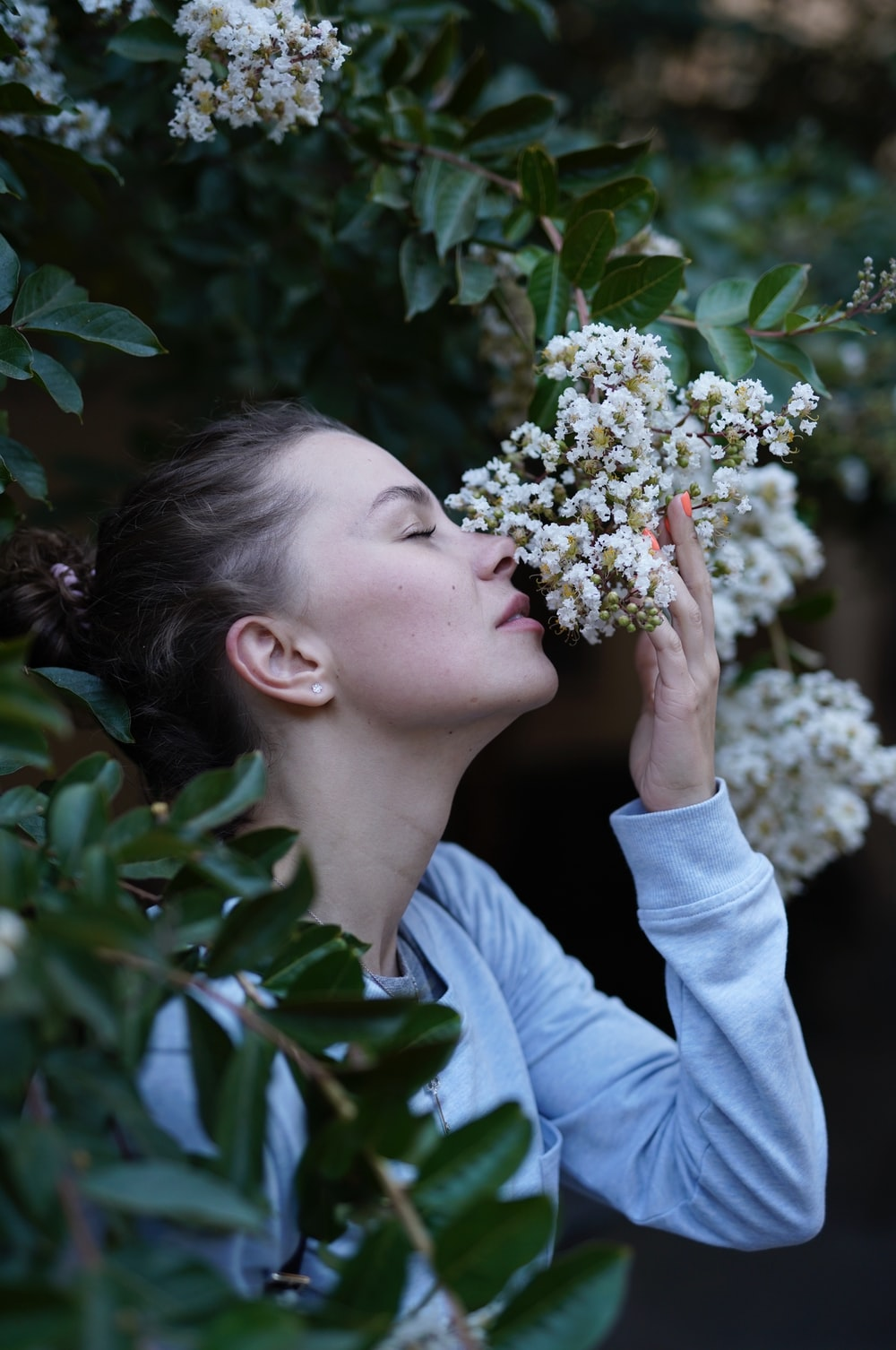 woman sniffing flower