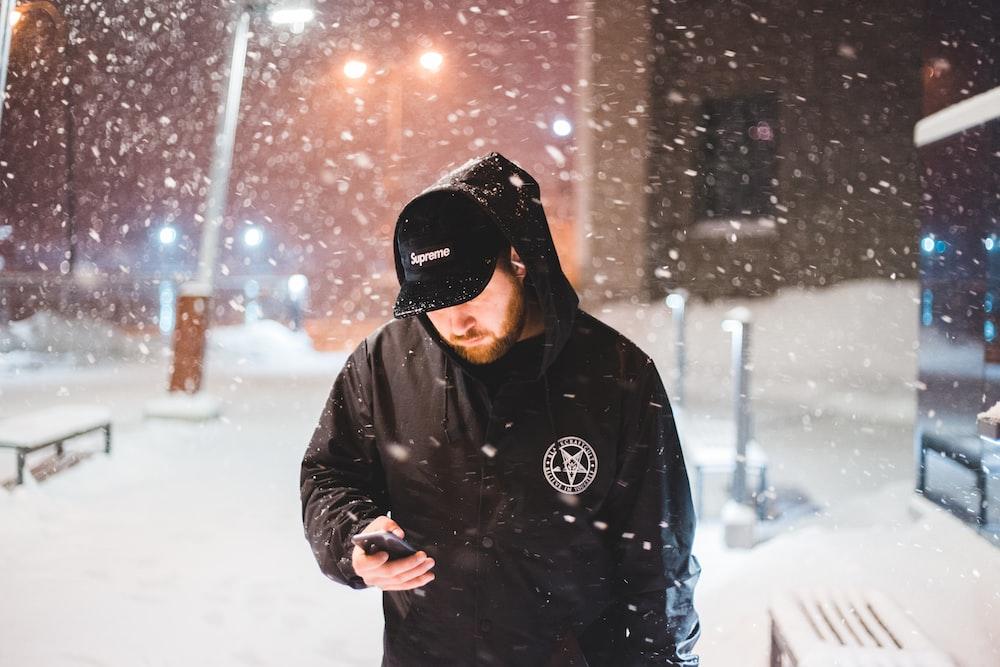 man looking at phone