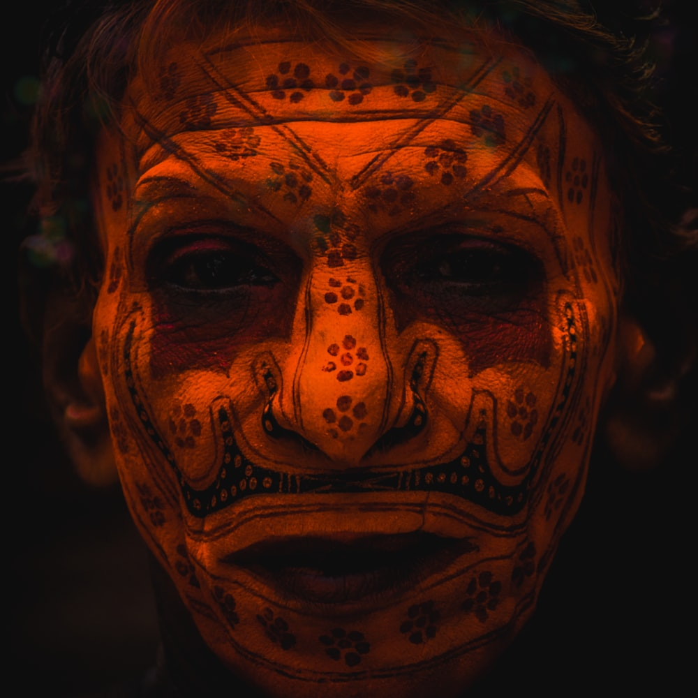 man's face with tattoo