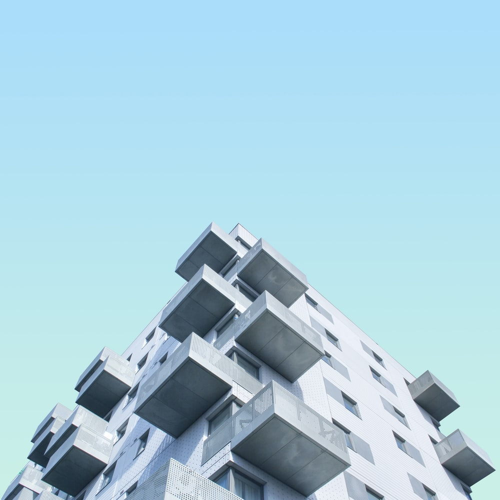 low angle photography of concrete building during daytime