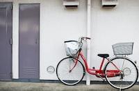 red and black step-through bike