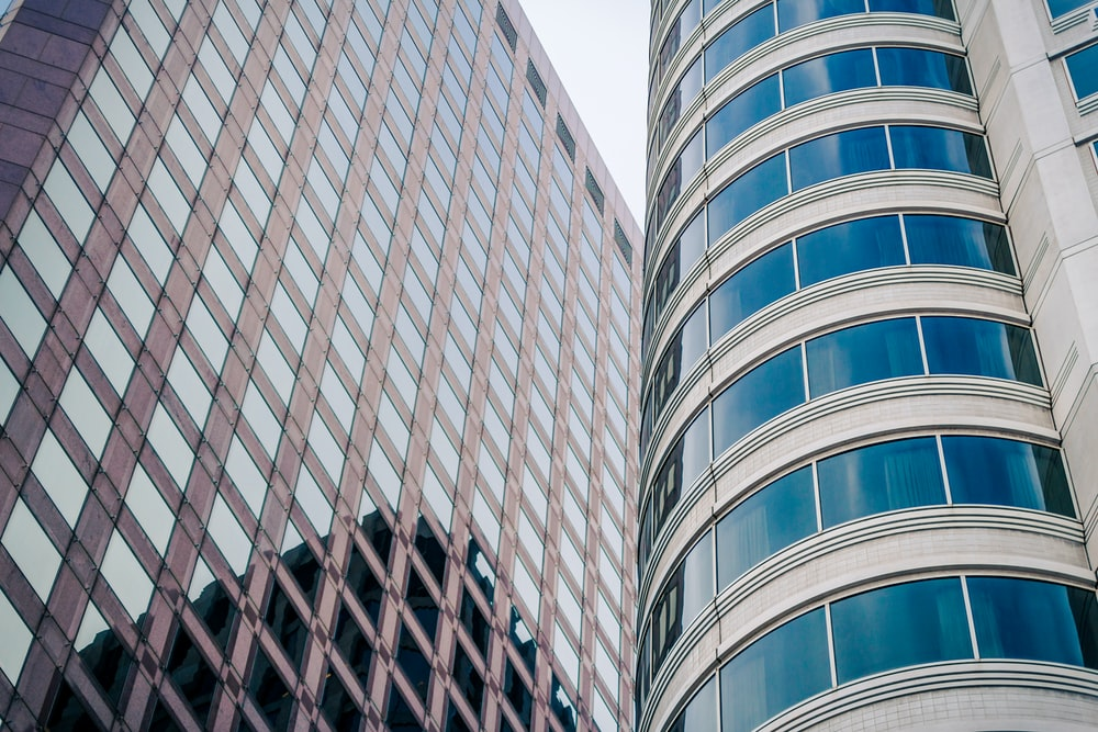 low-angle photography of high rise buildings