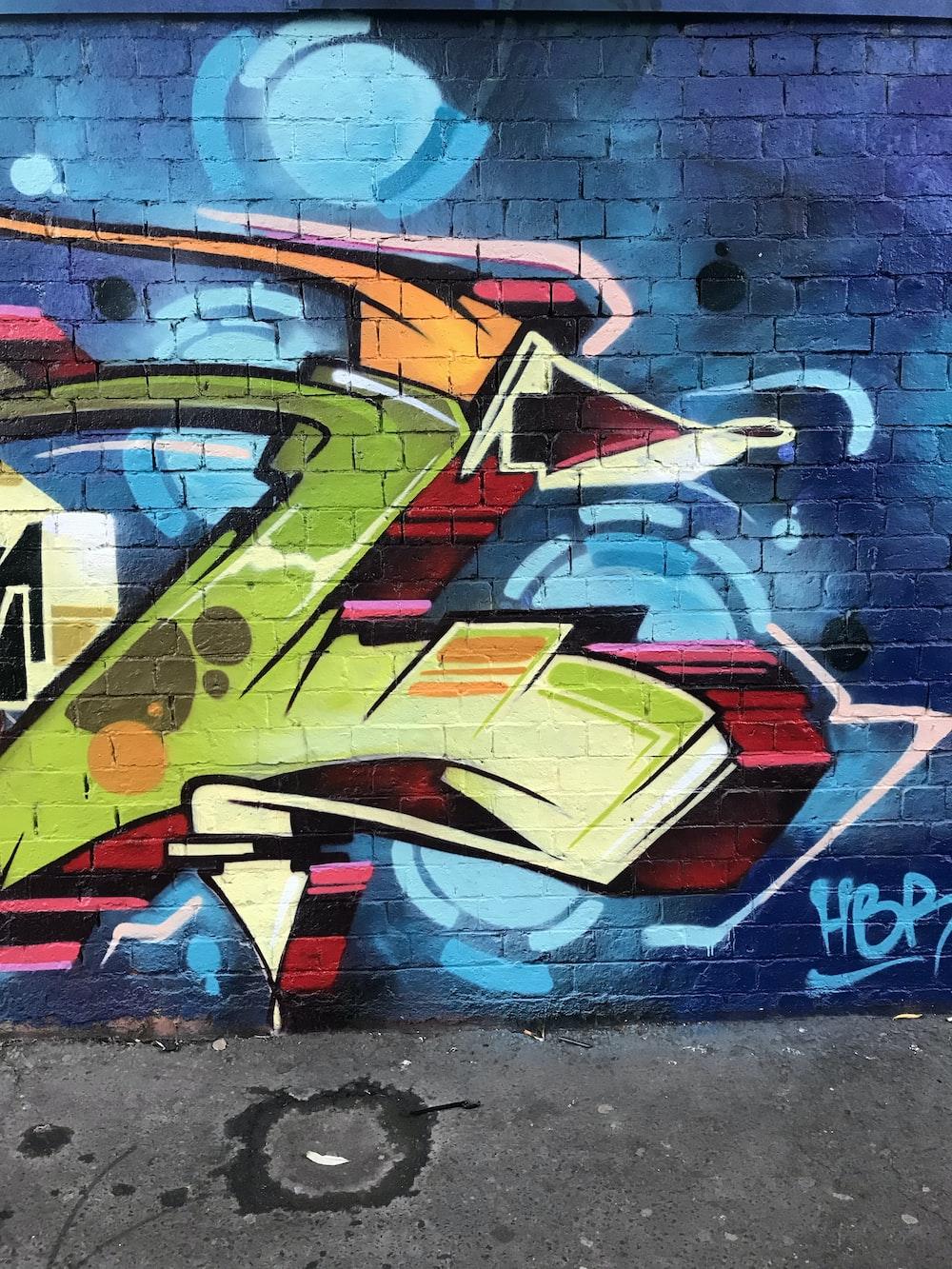 blue, green, and pink graffiti wall