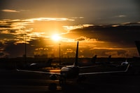 airplane on runway during golden hour