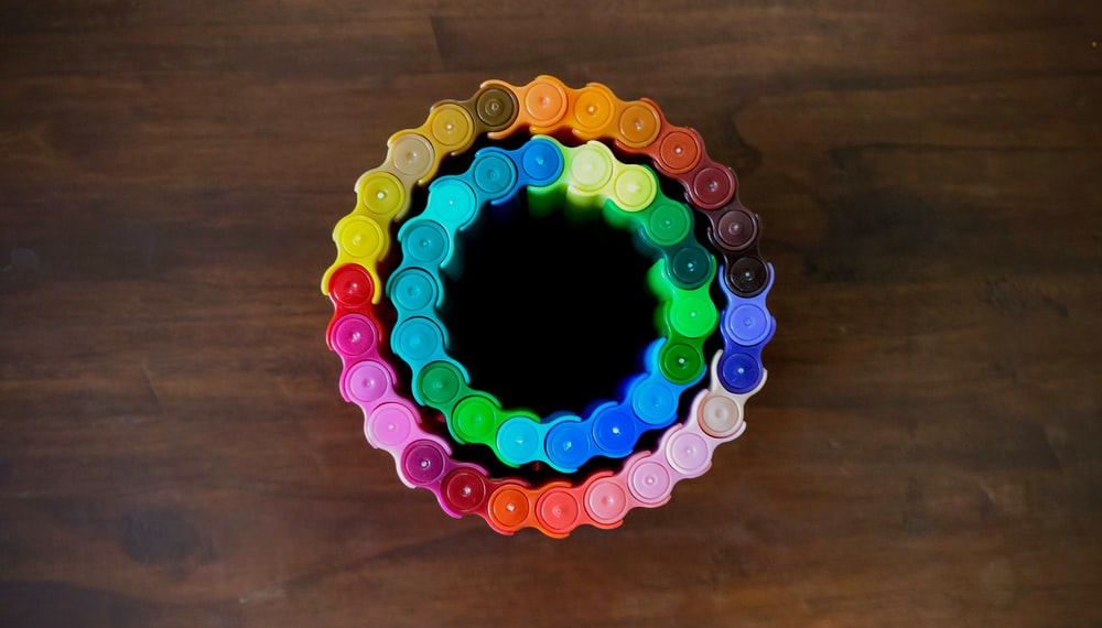 rainbow color chain on brown surface