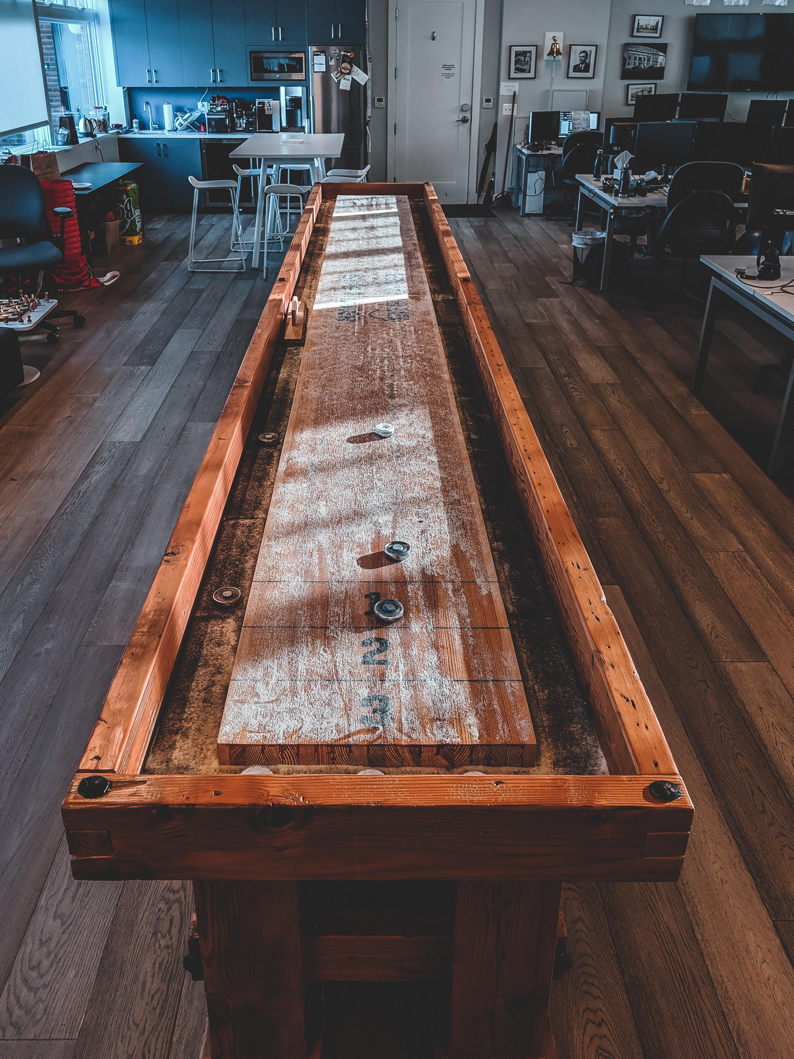 rectangular brown wooden game table