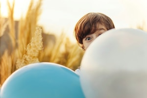woman hiding on balloon