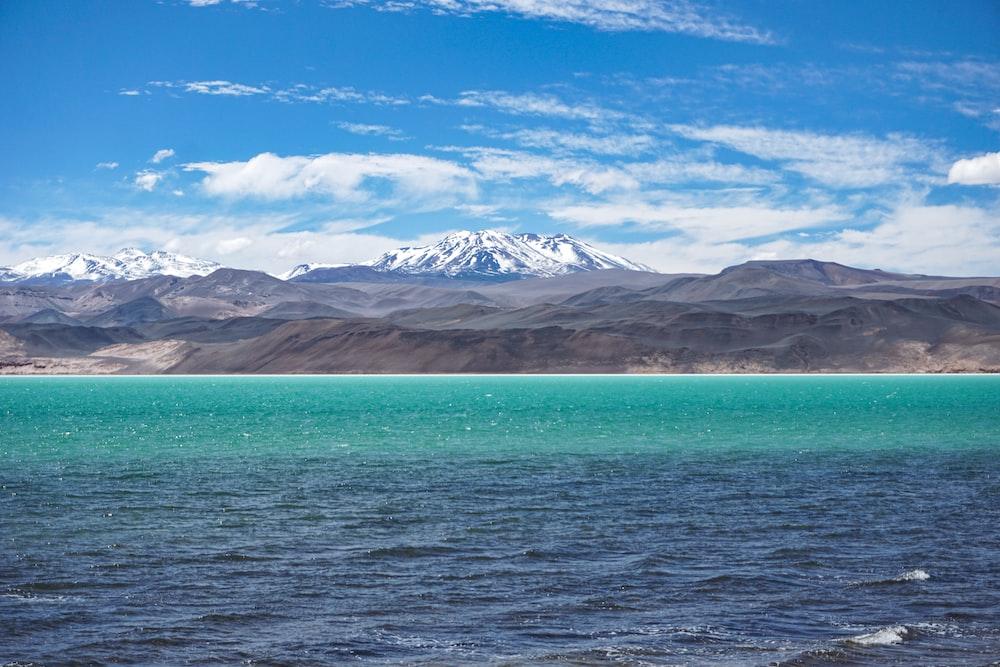 clear blue sea near mountain