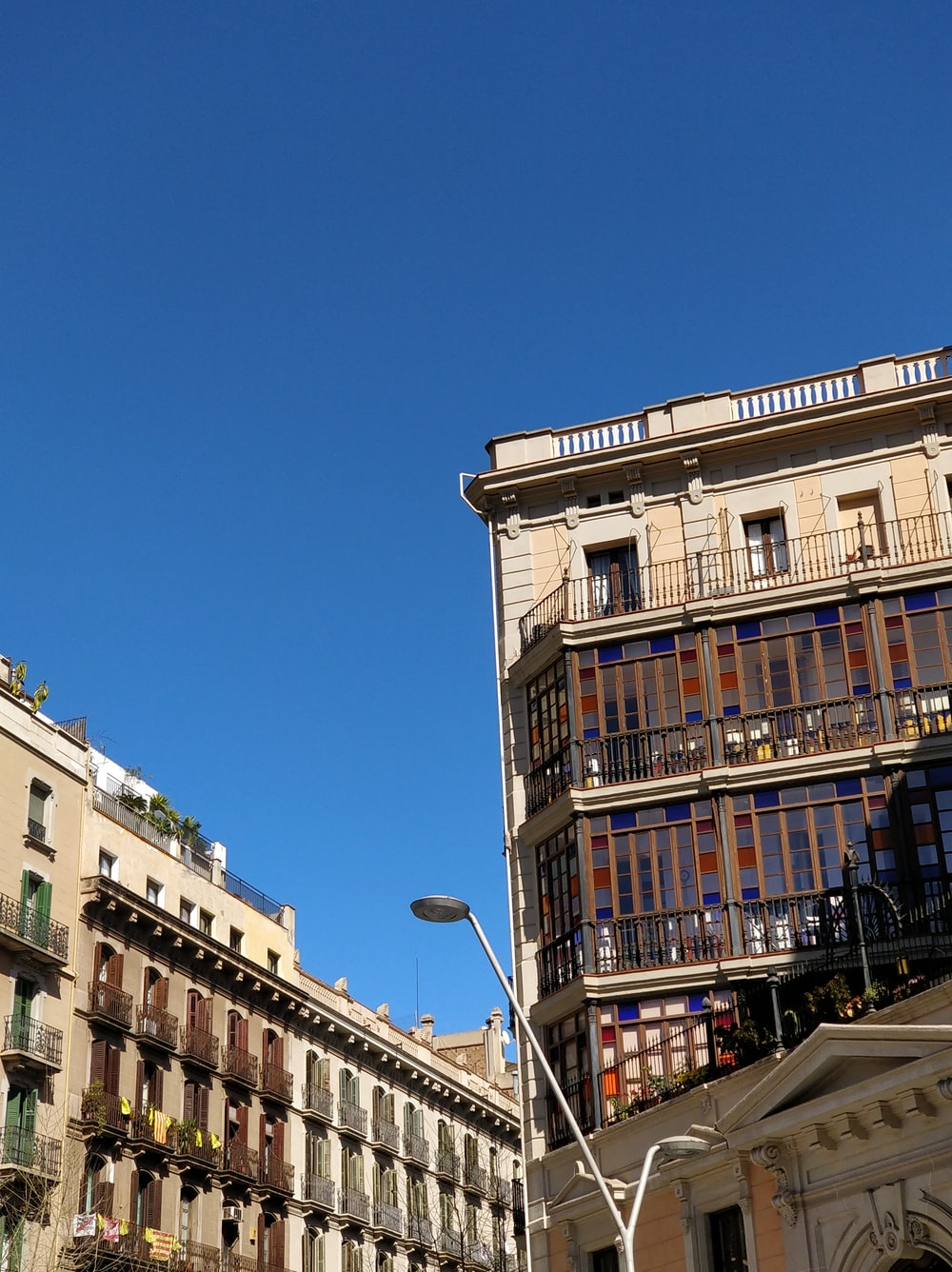 two high rise buildings under blue sky