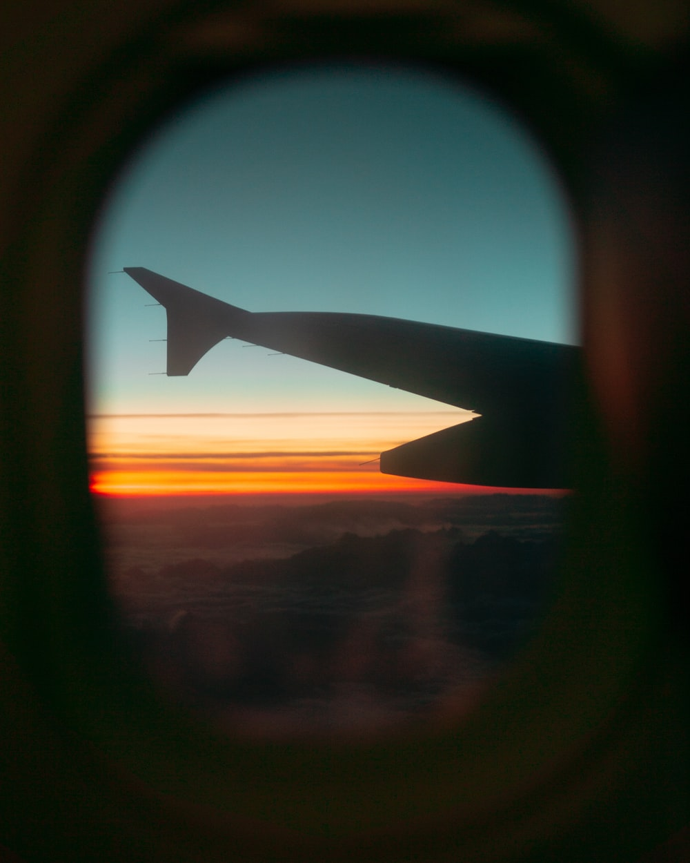 wing of airliner during golden hour