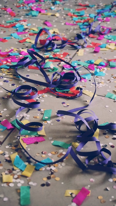 ribbons and confetti on floor\