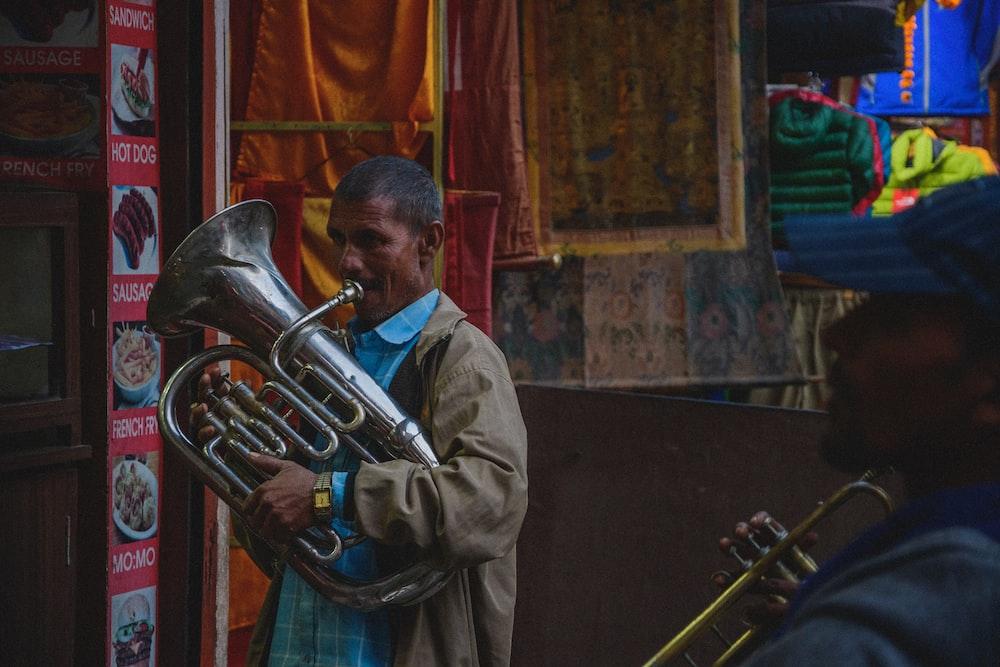 man playing silver tuba