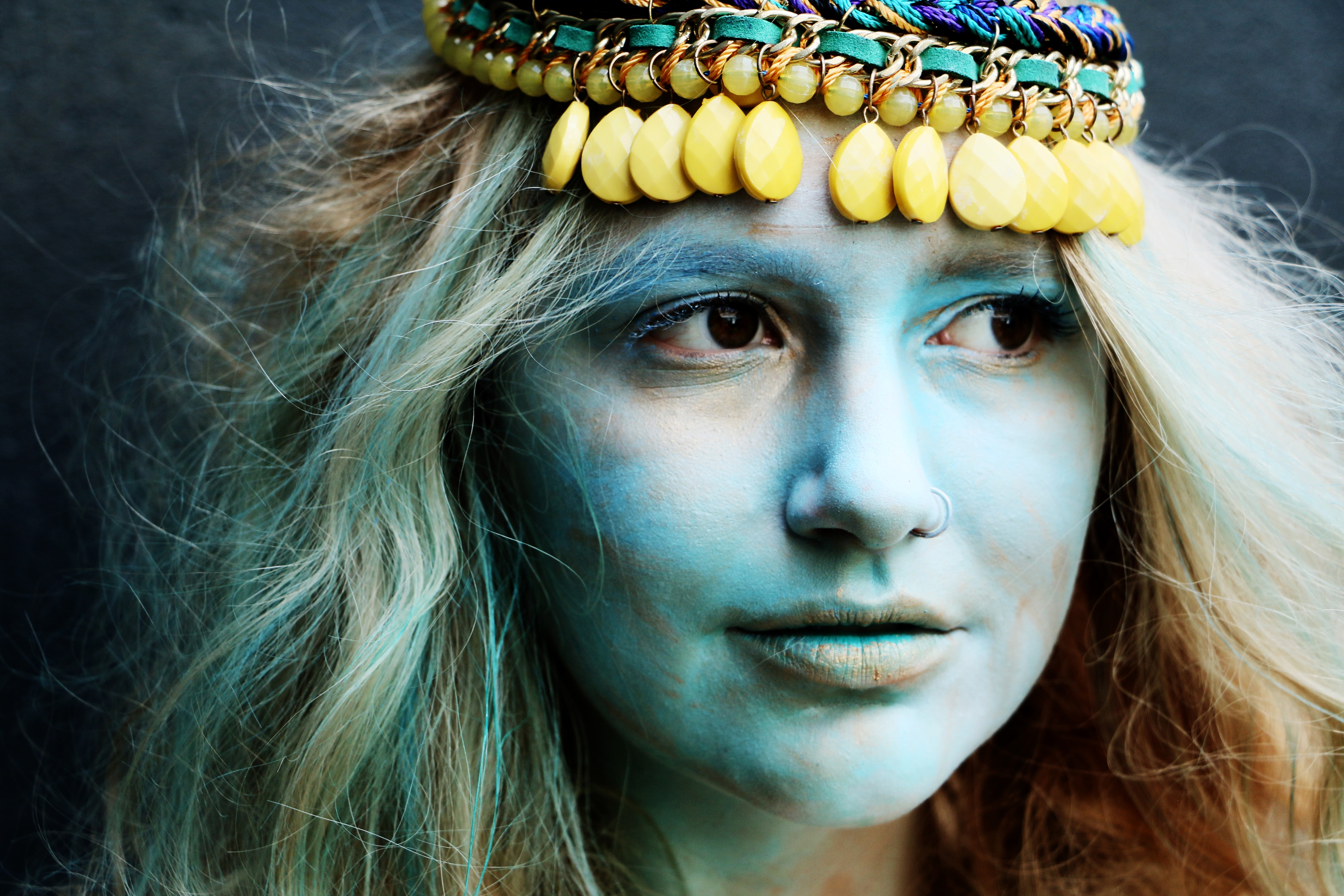 woman wearing blue and green traditional headdres
