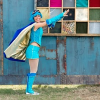 woman wearing anime costume about to fly position