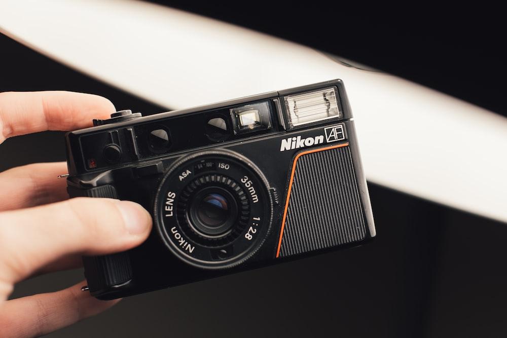black Nikon digital camera