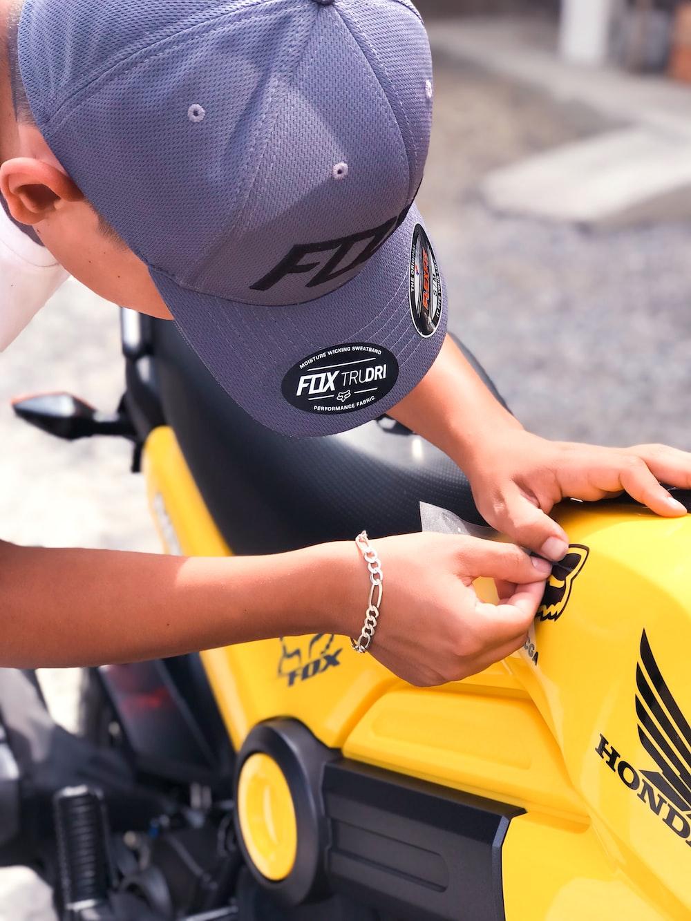 yellow and black Honda motorcycle
