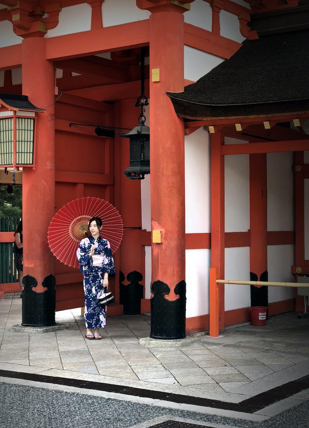woman wearing yukata with red umbrella