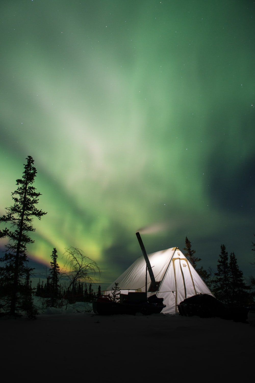 white camping tent and green Arora sky