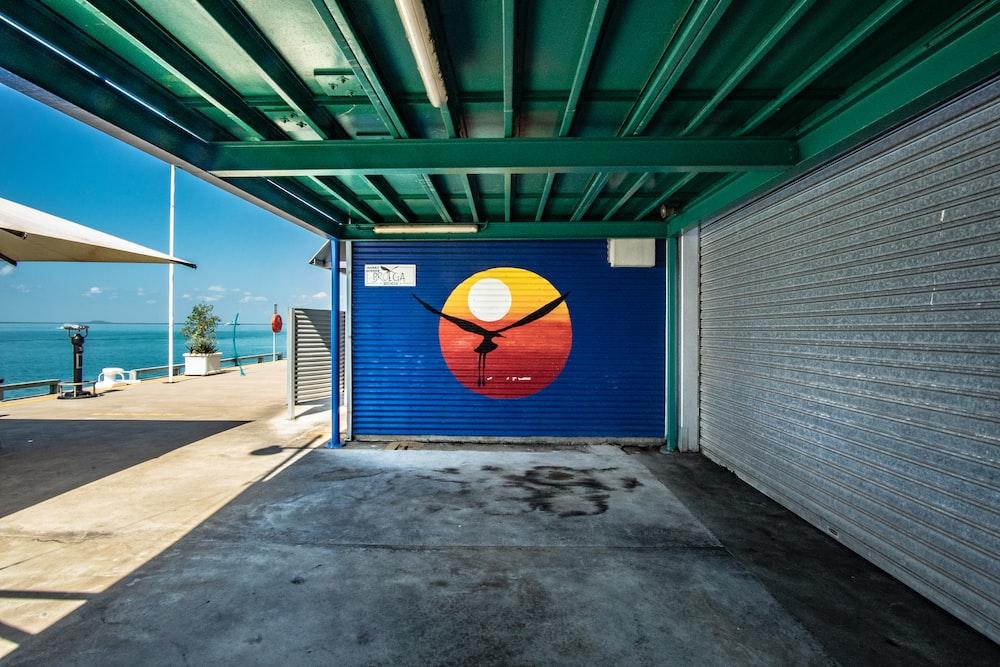 brown bird painted roll-up door
