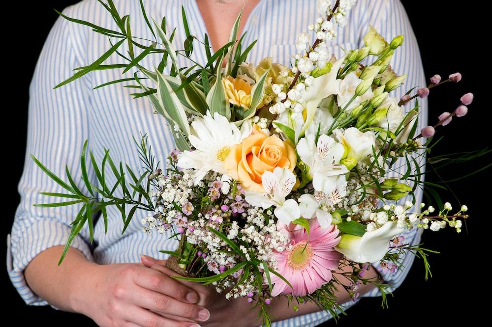 man holding bouquet of flower