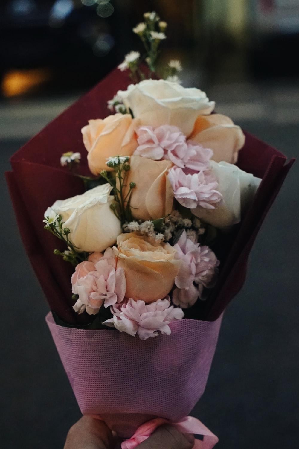 selective focus photography of white and orange rose flower bouquet