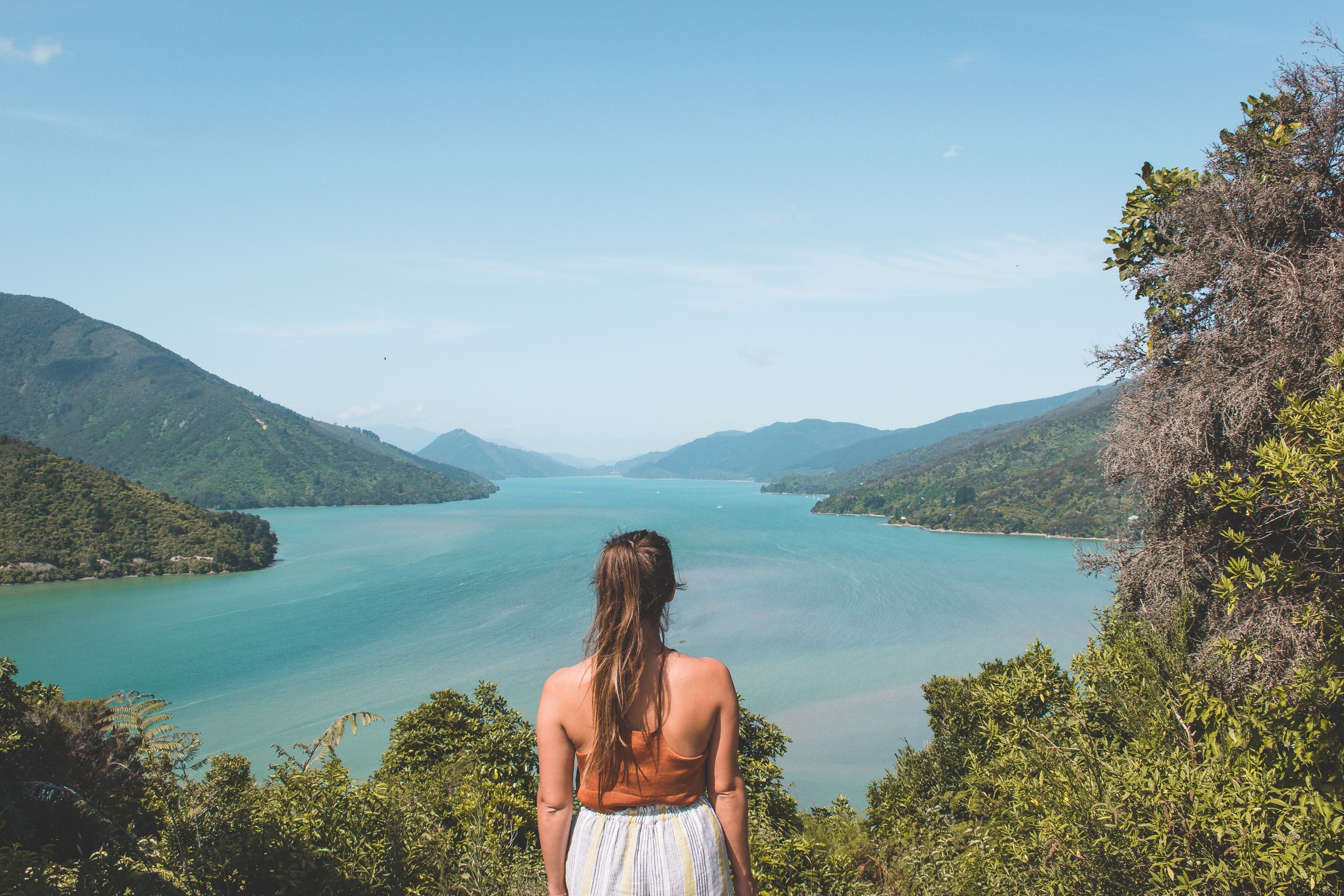woman looking at body of water during daytime