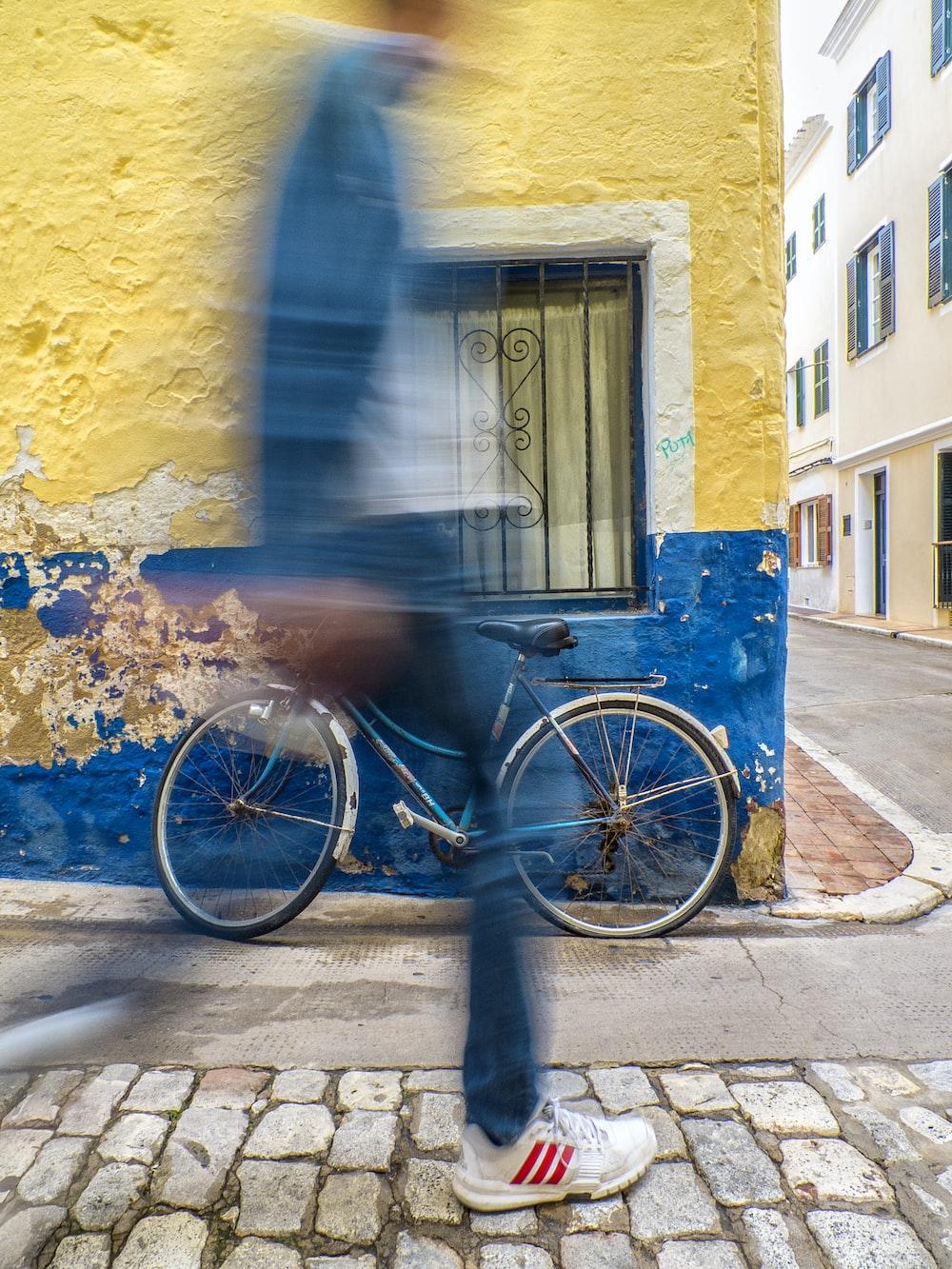 time lapse photo of person near bike