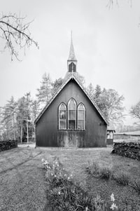 grey wooden building in grayscale photography