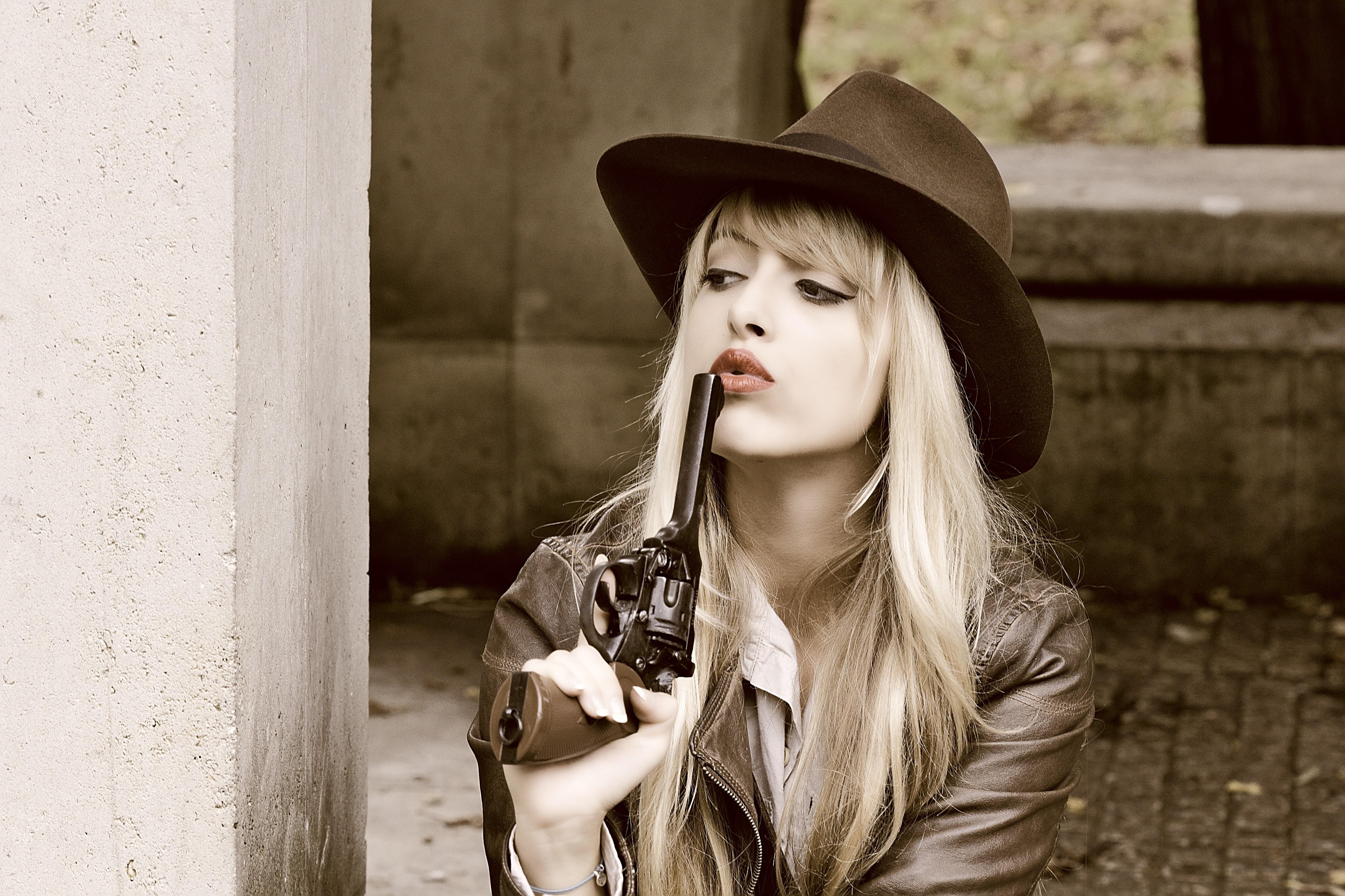 woman holding revolver