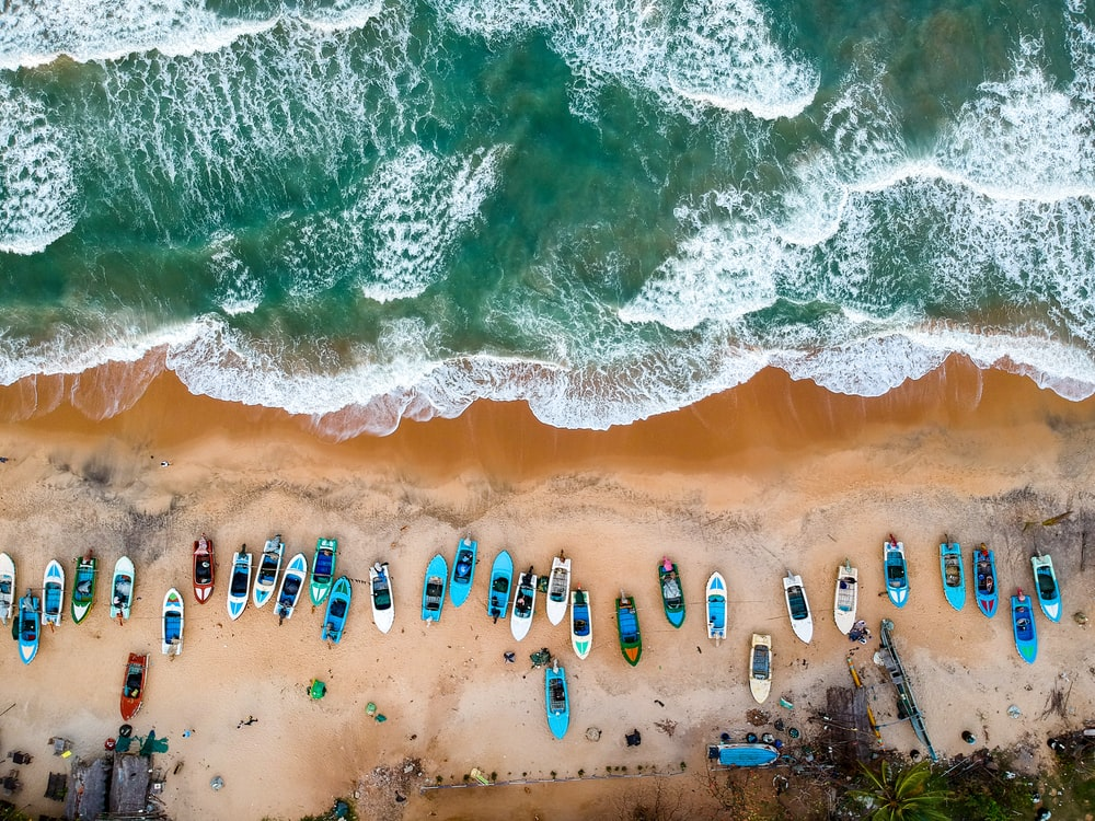 aerial photography of boats on shore during daytime
