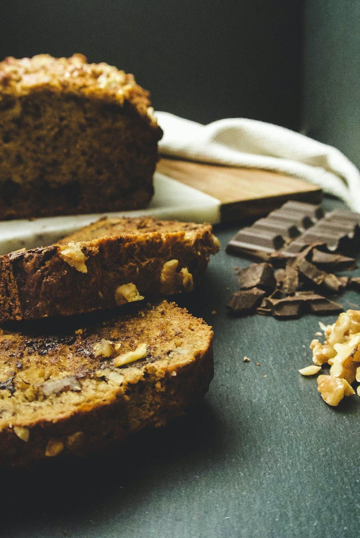 sliced cake near chocolates