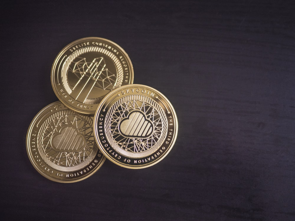 three round gold-colored coins
