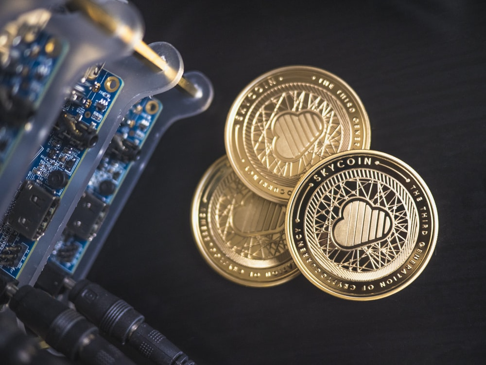 three round gold-coloredcoins