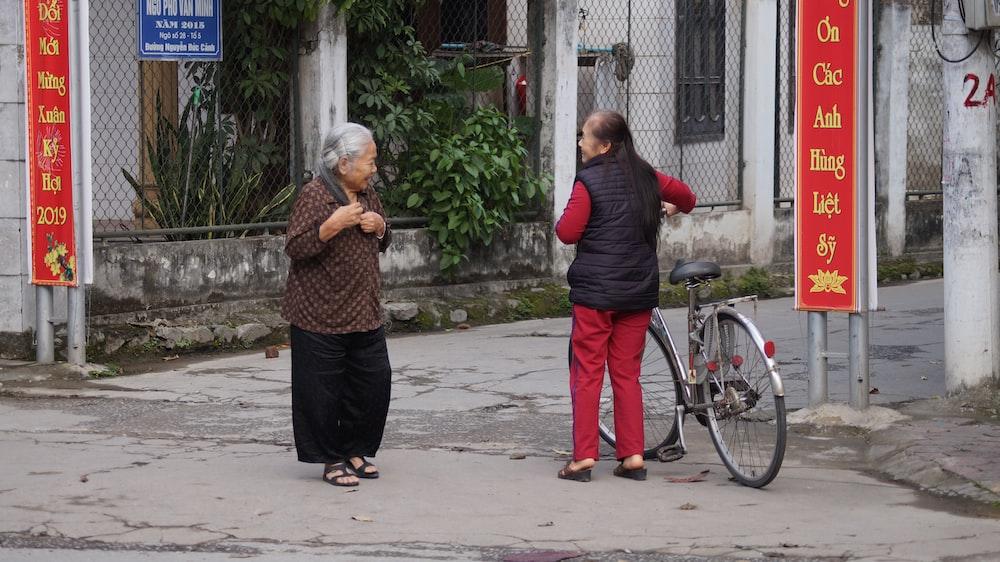 two women talking on road