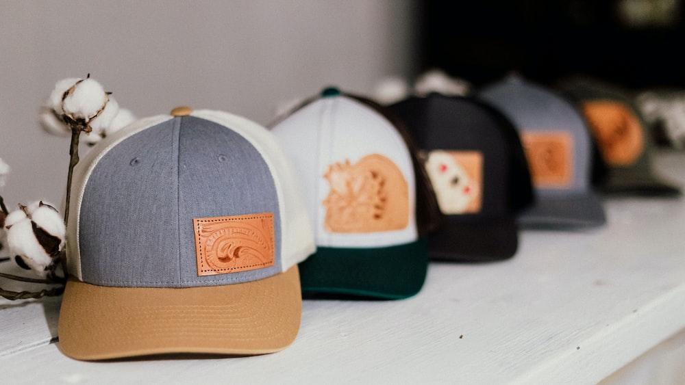 five assorted-color baseball caps