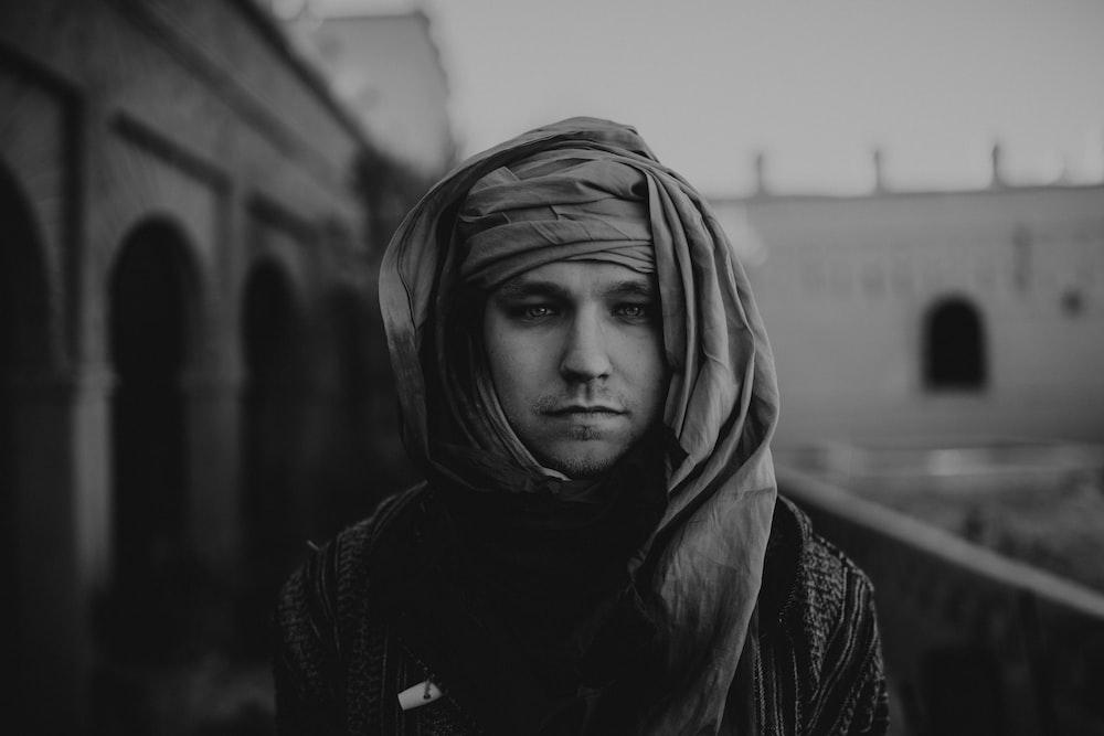 grayscale photo of man wearing headscarf