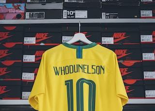 yellow Whodunelson 10 soccer jersey hanging on shoebox rack