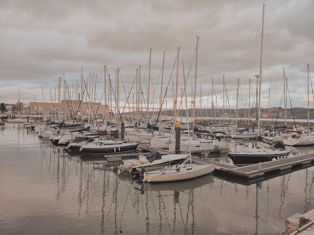 cuddy boat parked beside beach dock under nimbus clouds