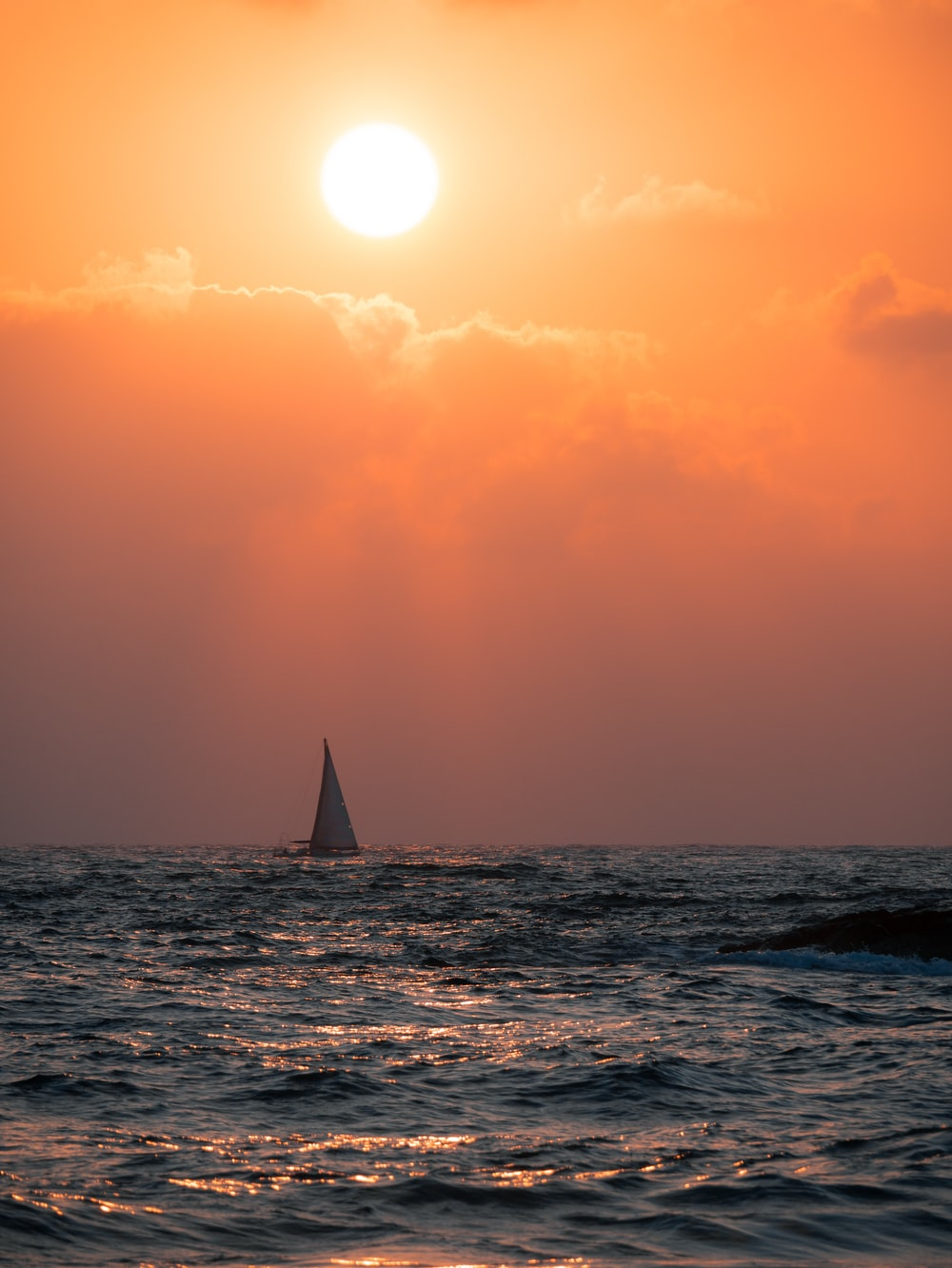 sailing boat on sea during daytime