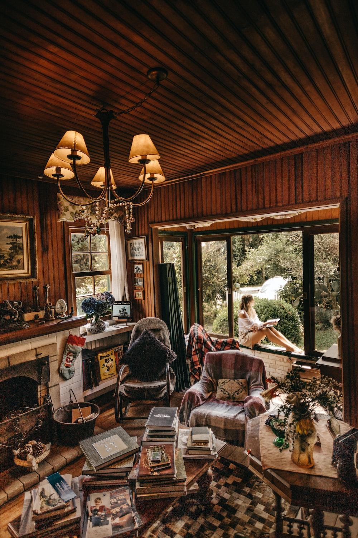 woman sitting on window inside room