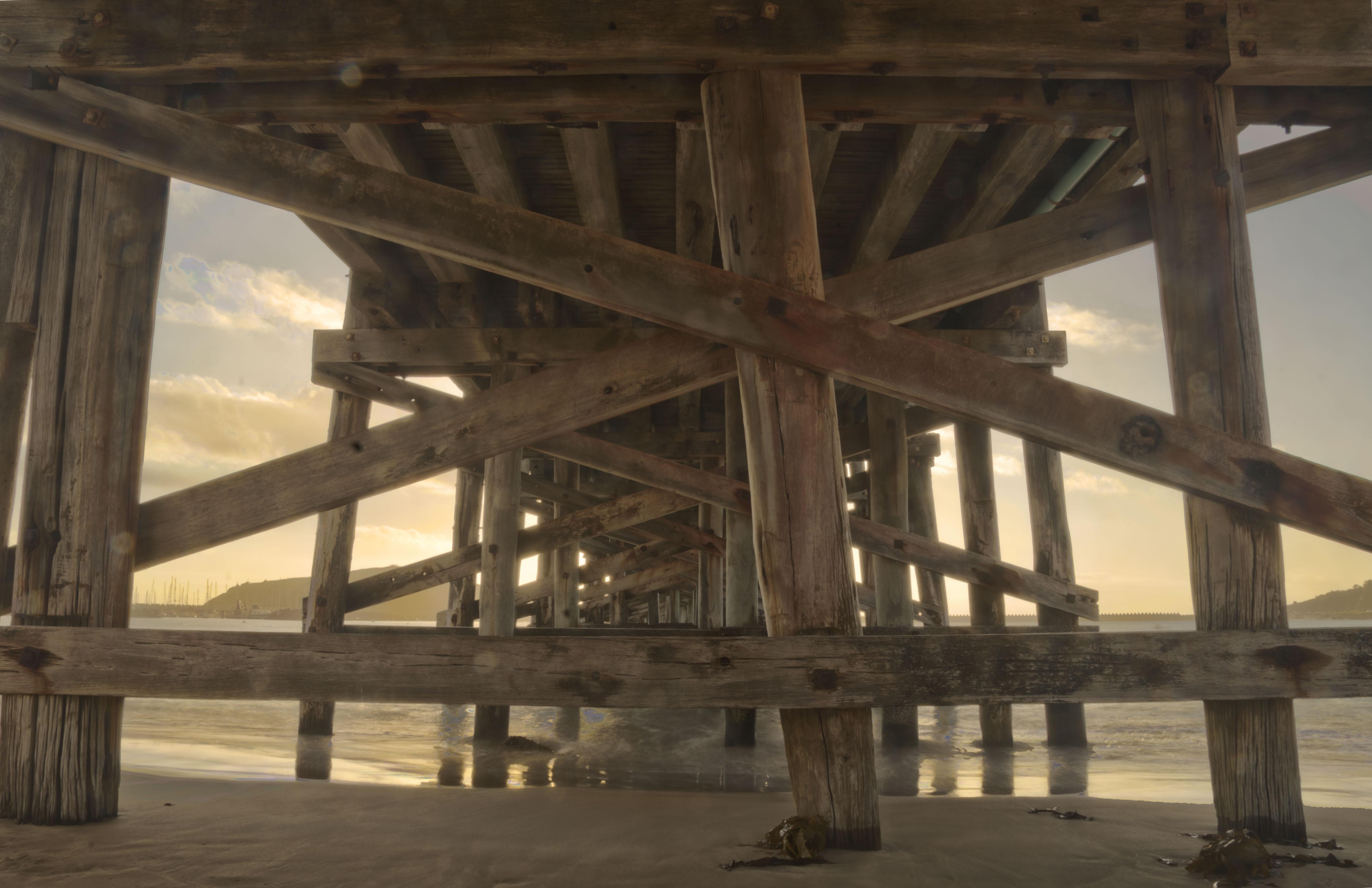 brown wooden dock trusses