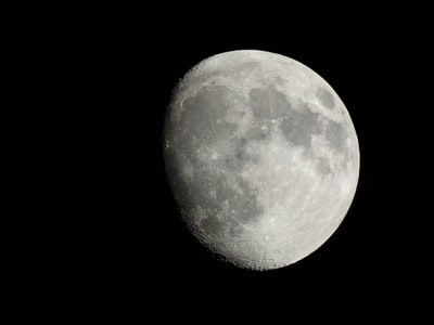 grayscale photography of quarter moon outer-space zoom background