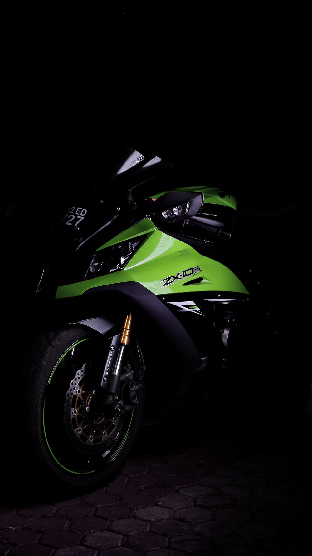 green and black sports bike