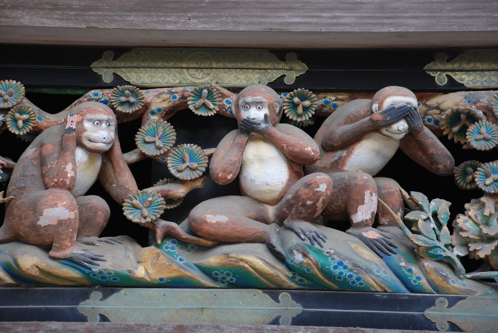 three wise monkey statue
